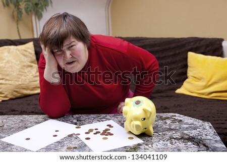 handicapped woman look desperate in front of her bills