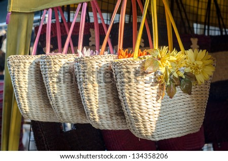 Handicraft bags hanging in row for purchasing