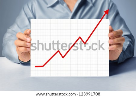 handing a blank business a4 card over in hand and graph
