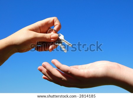 handing keys from one person to another symbolizing success or partnership