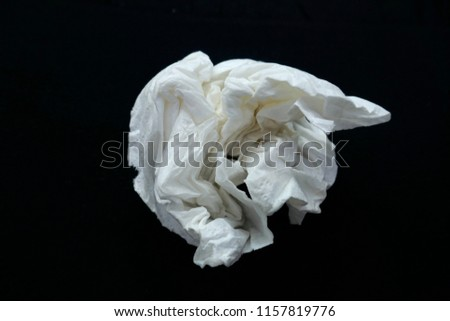 Handkerchief, paper handkerchief, crumpled, close-up, isolated on black background. - Shutterstock ID 1157819776