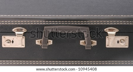 Handle and locks on a vintage suitcase