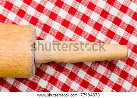 Handle from rolling pin on a striped tablecloth