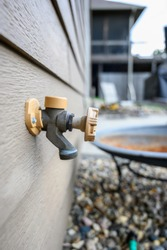 Handle-Operated Freezeless Residential Wall Hydrant mounted on exterior of house