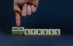 Handle stress symbol. Businessman turns cubes and changes words 'stress' to 'handle stress'. Beautiful grey background. Medical, psychological, handle stress concept. Copy space.