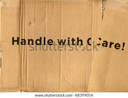 Handle with care  - brown corrugated cardboard parcel