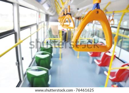 Handles for standing passenger inside a bus.