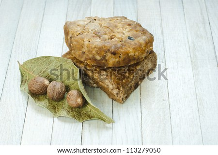 handmade african black soap and ingredients, shea butter nuts, dried leaves
