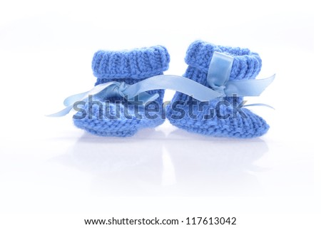 Handmade  baby booties isolated on a white background