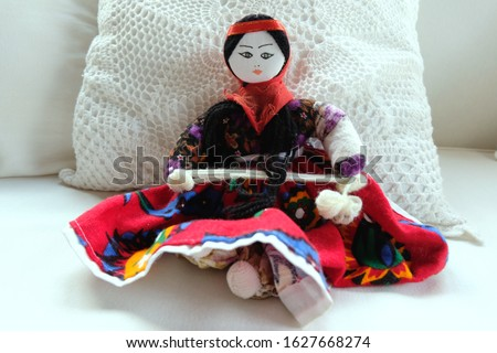 Handmade Baby doll sitting in front of a pillow Stok fotoğraf ©