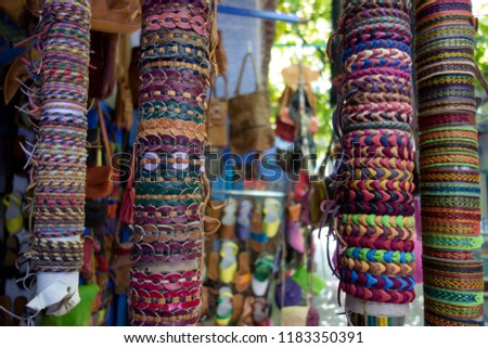 Handmade bangles stand on a street in Morocco #1183350391