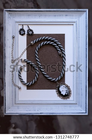 Handmade bead and cameo decoration. #1312748777