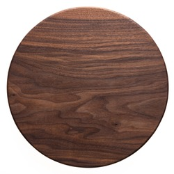 Handmade black walnut round wood plate. Walnut round wooden tray. Black walnut wood plank texture background.
