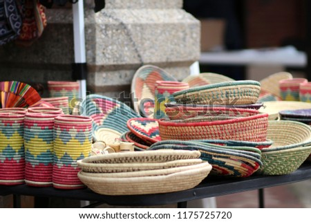 Handmade Brightly Colored Woven Basket Bowls on Display Table For Sale #1175725720