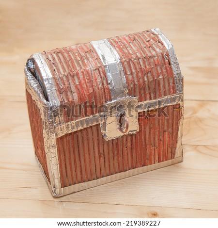 Handmade carton closed treasure chest for kids treasure hunt quest.