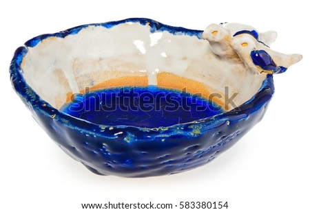 Handmade ceramic bowl with two birds in love on the edge of the dish. The cup in color blue, navy blue, white, yellow, cream. At the bottom of the dish broken melted and cracked glass. #583380154