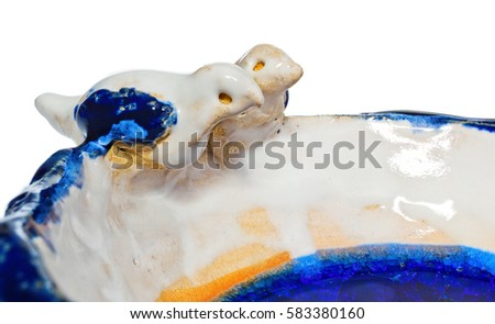 Handmade ceramic bowl with two birds in love on the edge of the dish. The cup in color blue, navy blue, white, yellow, cream. At the bottom of the dish broken melted and cracked glass. #583380160