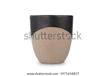 Handmade ceramic coffee mug or tea cup isolated on white background with clipping path. Coffee mug or tea cup is made of clay pottery or ceramic. Ceramic Coffee mug with handle and handcraft concept.  ストックフォト ©