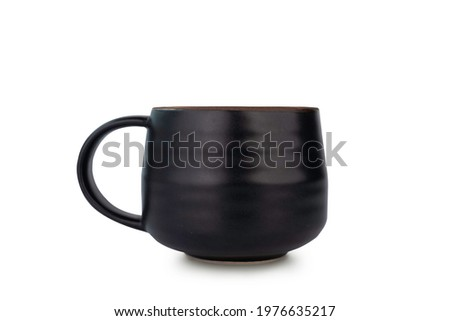 Handmade ceramic coffee mug or tea cup isolated on white background with clipping path. Coffee mug or tea cup is made of clay pottery or ceramic. Ceramic Coffee mug with handle and handcraft concept.  Сток-фото ©