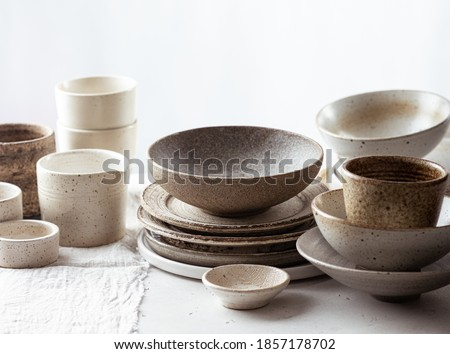 handmade ceramic tableware, empty craft ceramic plates, bowls and cups on light background  Сток-фото ©