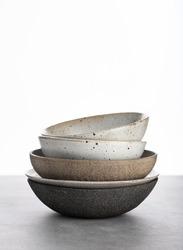 handmade ceramics, empty craft ceramic bowls on light background