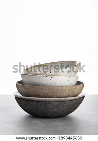 handmade ceramics, empty craft ceramic bowls on light background  ストックフォト ©