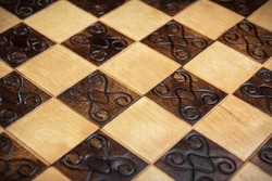 handmade chessboard, close-up, side view, beautiful drawing on wood