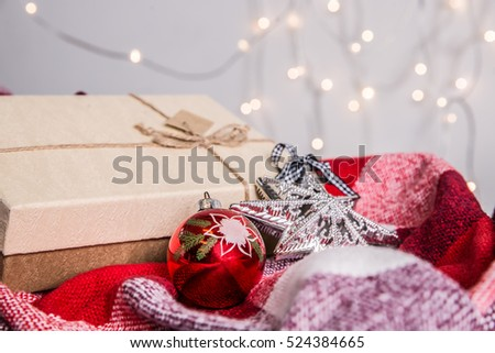 Handmade christmas gift box with decorations against bokeh lights background. Side view. Christmas composition. #524384665
