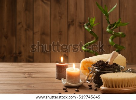 Handmade Coffee Scrub With Argan Oil. Burning Candles. Decorative Bamboo Shoots. Spa Room
