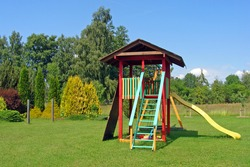 Handmade colorful wooden tower on children playground.