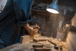 Handmade concept. Workshop on wood. Women's hands create a product made of wood