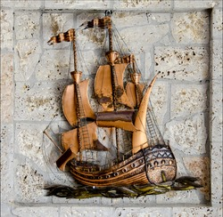Handmade creation with bronze ship and stones