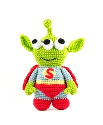 handmade crochet green alien three eyes super hero doll on white background, front side