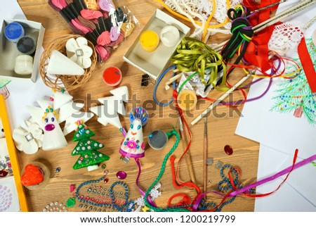 Handmade decorations for new year and other holidays. Artwork workplace with creative accessories.