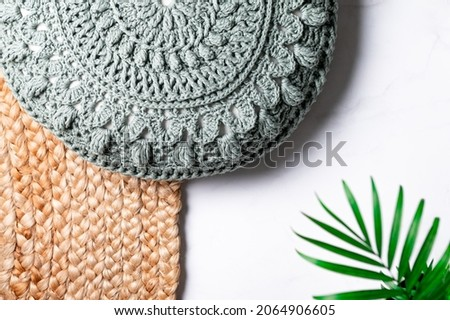 Handmade Decorative Green Crochet Round Cotton Cushion or Pillow on Jute Rug