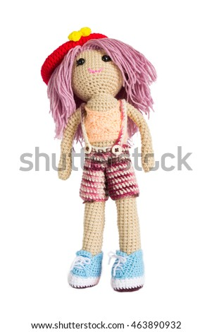 Handmade doll on white background
