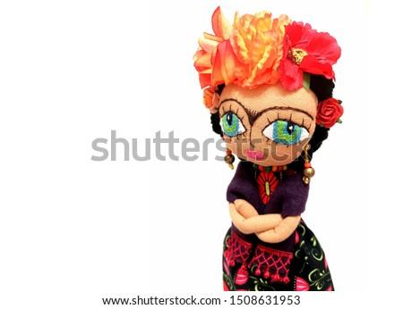 Handmade fabric Art Doll on white background