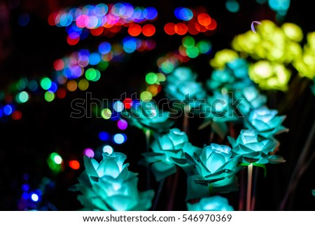 Handmade Flower with LED light at night. Artificial lotus flowers made of cloth and background bokeh. #546970369