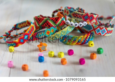 handmade friendship bracelets with colorful threads #1079093165