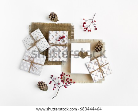 Handmade gift boxes on white background. Rustic style, cute paper DIY decoration on sackcloth napkins. Valentine's day or other holiday concept. Flat lay, top view