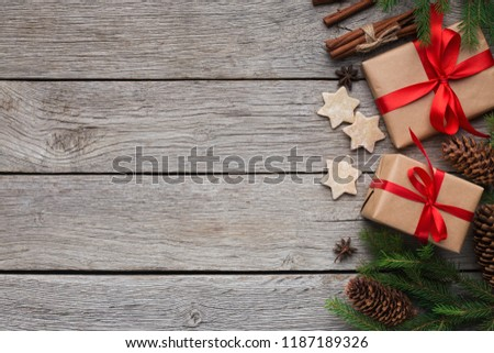 Handmade gift boxes with Xmas tree and cookies on rustic wooden background, top view, copy space #1187189326