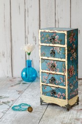 Handmade gilded mini chest of drawers in a vintage floral style