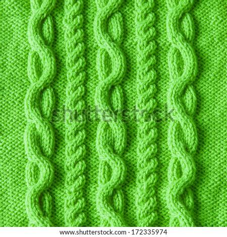 Handmade green knitting wool texture background