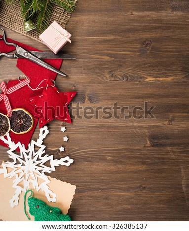 Handmade holiday decorations and vintage scissors at left side of table top view #326385137