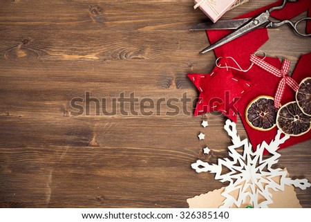 Handmade holiday decorations and vintage scissors at right side of table top view #326385140