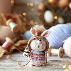 Handmade knitted toy. Amigurumi bunny toy. Crochet stuffed animals. Miniature crochet rabbit
