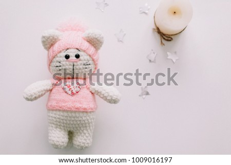 Handmade knitted toy cat on white. Hello kitty. flat lay, top view  - Shutterstock ID 1009016197