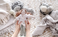 Handmade knitted toys with balls of thread . Concept of Hobbies and crafts .
