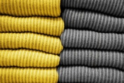 Handmade knitting wool texture background.Illuminating and Ultimate gray Pantone color of the year 2021