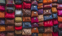 Handmade leather bags on display in Fes medina, Morocco